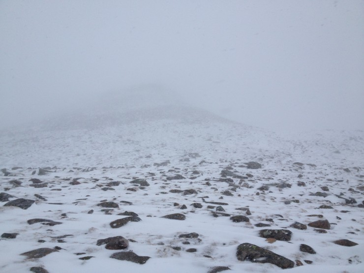 Snow falling at Lochnagar Col. No view of the cliffs.