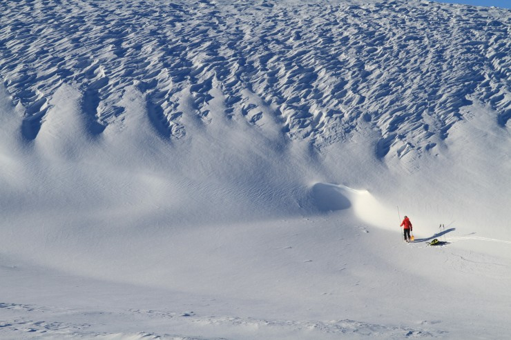 A mix of wind eroded and deeper softer snow.