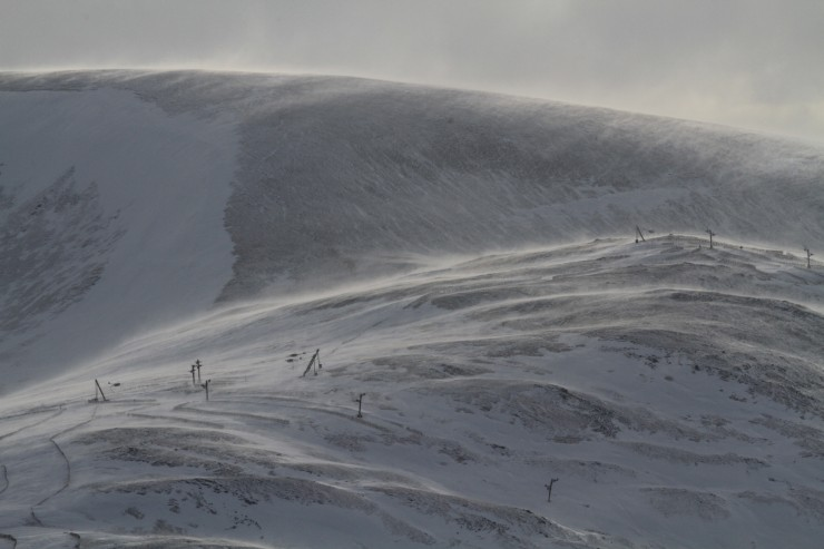 Very strong winds were redistributing snow and scouring open slopes.