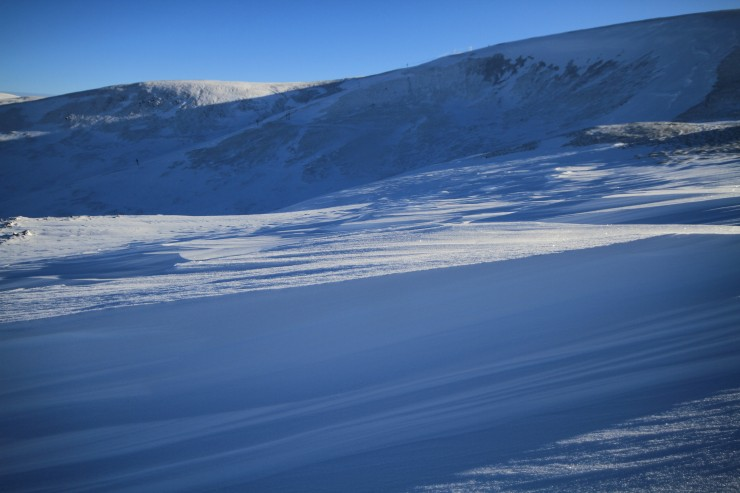 Some aspects have been scoured in places, half a metre of snow depth gone from here.