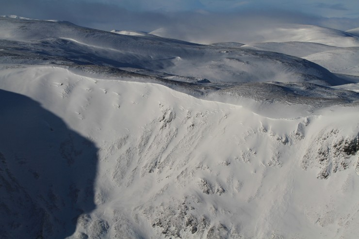 Wind lips and cornices have built up over lee slopes.