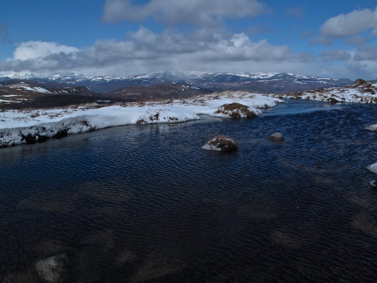 A bright and blustery day. 0  degrees at 950 metres, not enough to re-freeze this lochan.