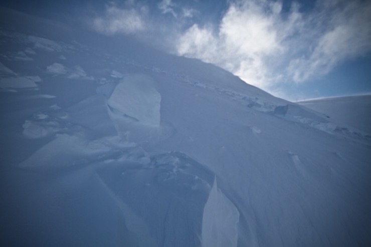 Cornice and avalanche debris with continuous drifting onto the face.