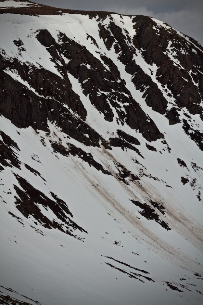Many crags have avalanche debris from them.